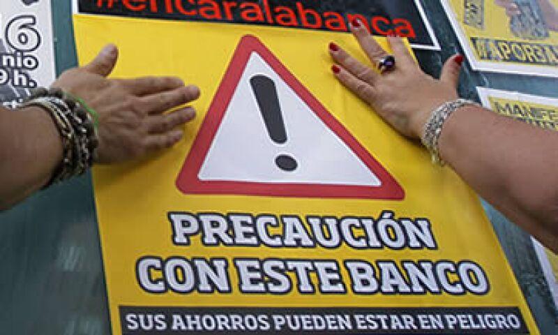 El BPI manifestó que los grandes bancos continúan empeñados en recurrir a deuda de alto riesgo. (Foto: AP)