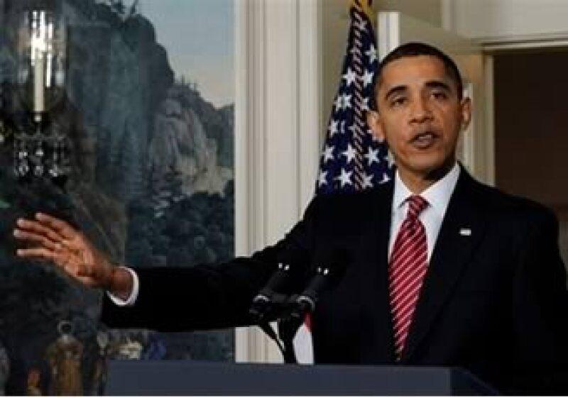 El presidente estadounidense se reunió con representantes de las instituciones financieras. (Foto: AP)