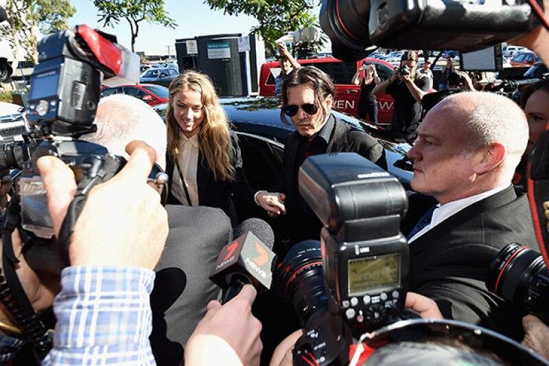 La esposa de Johnny Depp se ha librado de dos cargos por importación ilegal después de reconocer ante la justicia australiana que mintió para introducir a sus perros en el país.