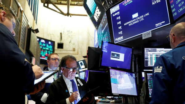 FILE PHOTO: Traders wait for stocks to resume trading on Norwegian Cruise Lines Holding Ltd. on the floor of the New York Stock Exchange in New York