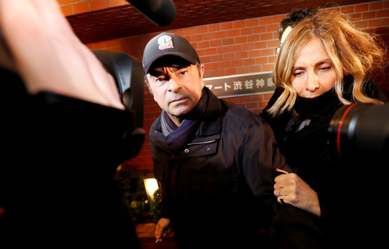 FILE PHOTO: Former Nissan Motor Chairman Carlos Ghosn and wife Carole Ghosn arrive at his place of residence in Tokyo