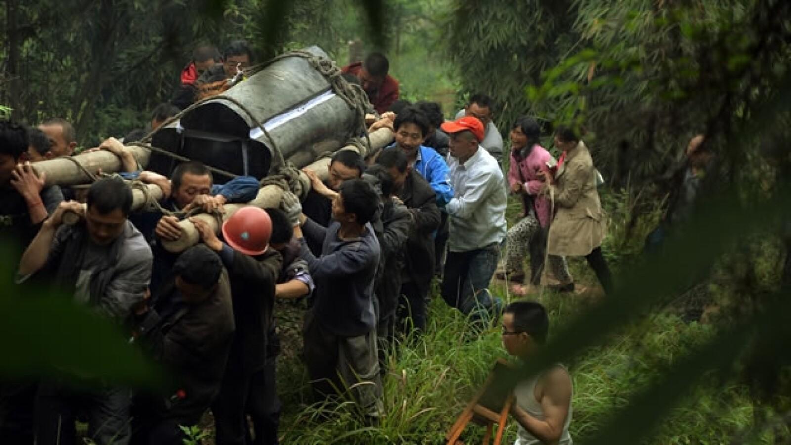 Traslado ataud sismo China