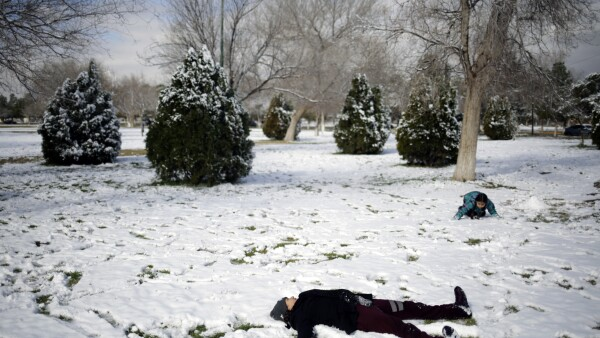 People play in the snow after a snowstorm in Ciudad Juarez