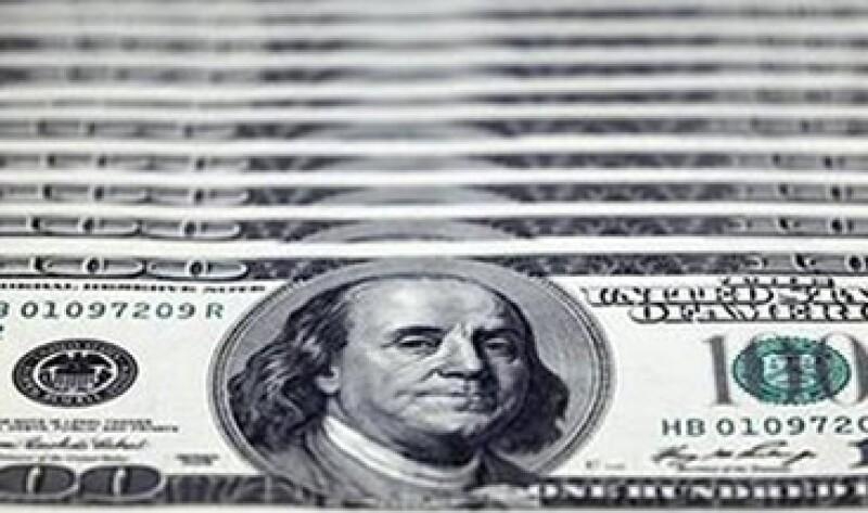 La Fed continuará reinvirtiendo deuda relacionada a hipotecas, por valor de unos 16,000 mdd al mes. (Foto: Reuters)