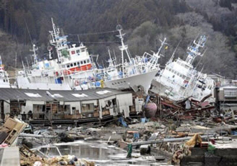 Economistas estiman que las pérdidas por el sismo podrían costarle a Japón unos 200,000 mdd. (Foto: AP)