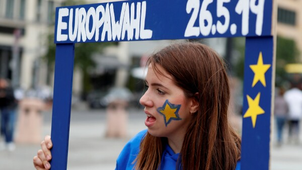 "FILE PHOTO: A woman attends an event by pro-European ""Pulse of Europe"" movement, during the European Parliament elections at Gendarmenmarkt square in Berlin"