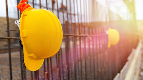 Yellow safety helmet in construction site.