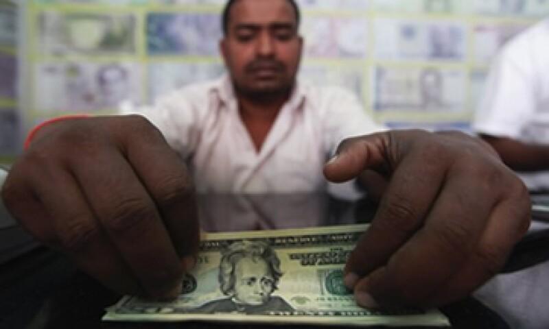El Banco de México fijó el tipo de cambio en 12.7764 pesos para solventar obligaciones denominadas en moneda extranjera. (Foto: Reuters)