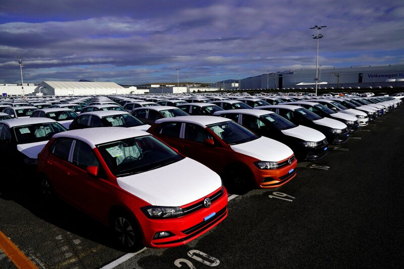 Volkswagen Polo models are parked outside the company's plant in Pamplona