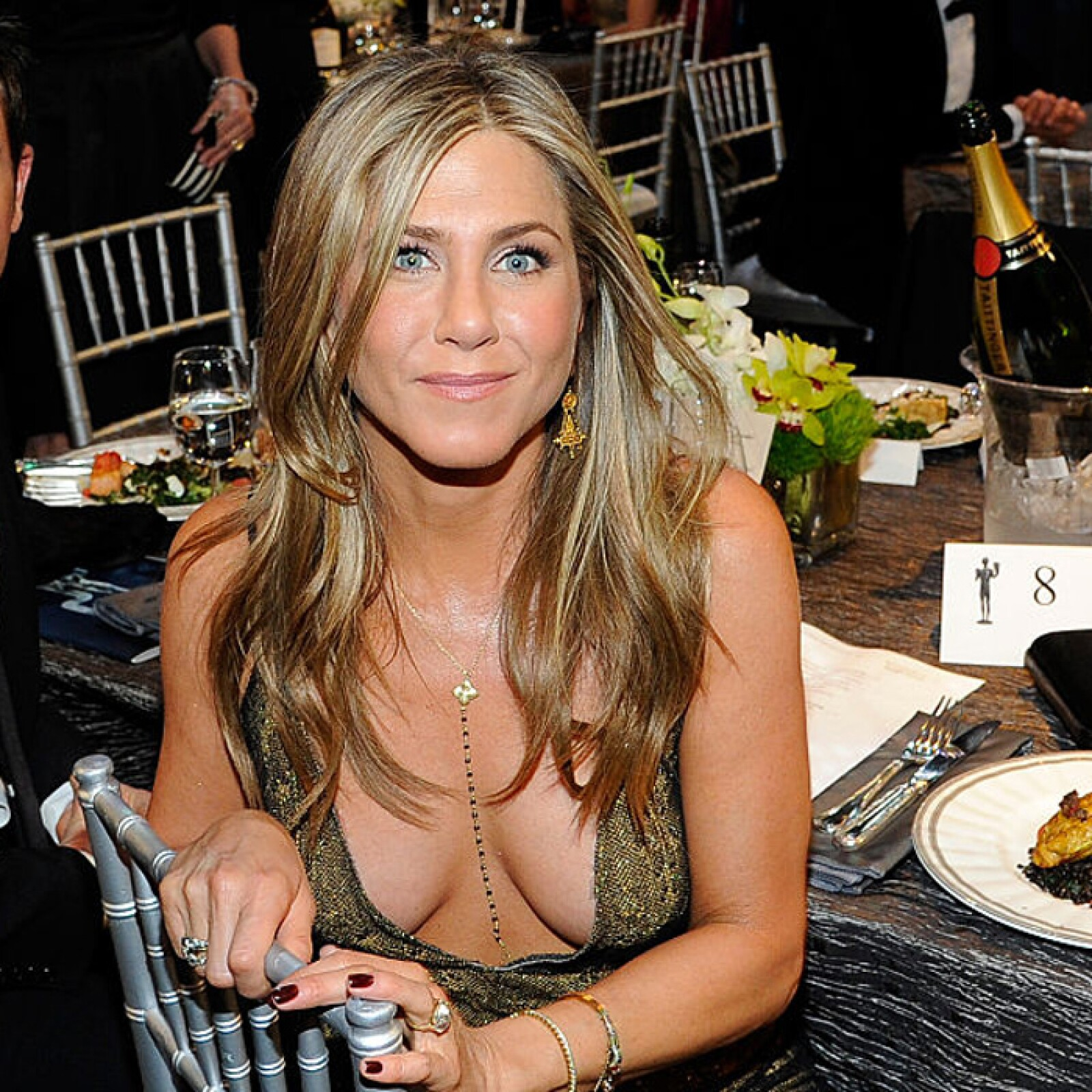 Jennifer aniston accidently exposes her nipples as she steps out in flimsy white vest