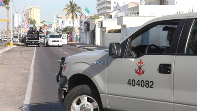 El narcotraficante fue detenido junto con otra persona, según anunció el procurador Jesús Murillo Karam.