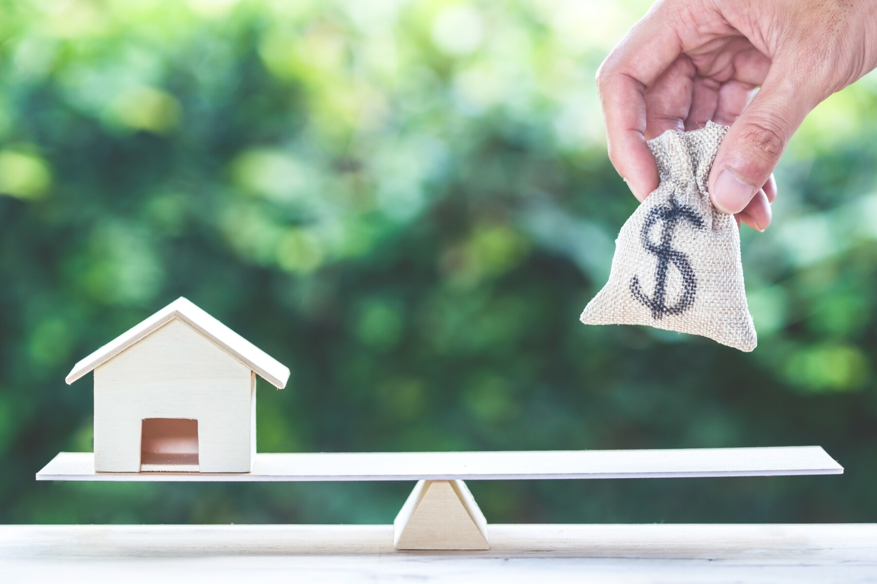 Balance home and money, home loan, reverse mortgage concept.