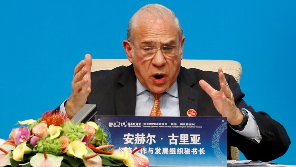 "FILE PHOTO: OECD Secretary-General Angel Gurria speaks at a news conference following the ""1+6"" Roundtable meeting at the Diaoyutai state guesthouse in Beijing"