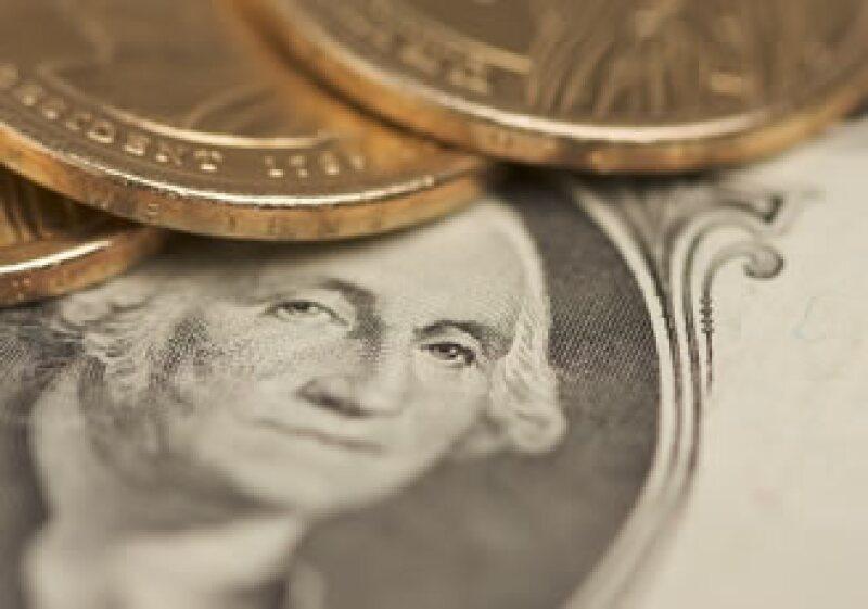 En ventanillas de bancos y casas de cambio, el peso operaba en 11.83 por dólar a la compra y 11.23 por dólar a la venta. (Foto: Photos to go)