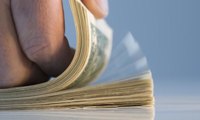 Banco Base estima que el tipo de cambio oscilará entre 12.94 y 13.03 pesos por dólar. (Foto: Getty Images)