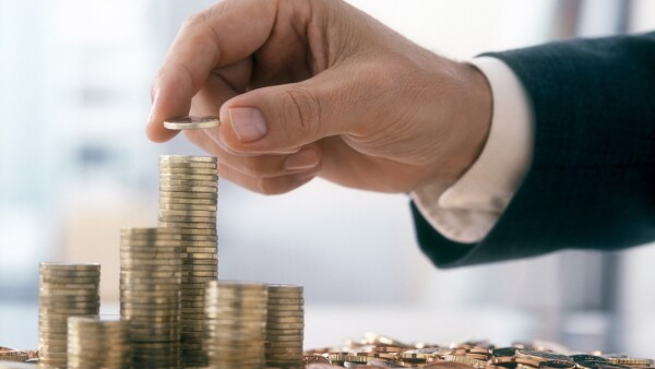 Businessman is stacking coins