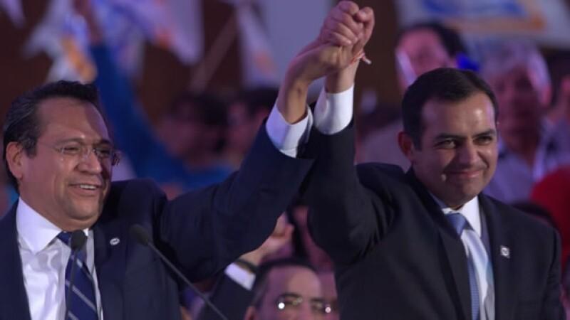Ernesto Cordero (derecha) y Juan Manuel Oliva (izquierda)