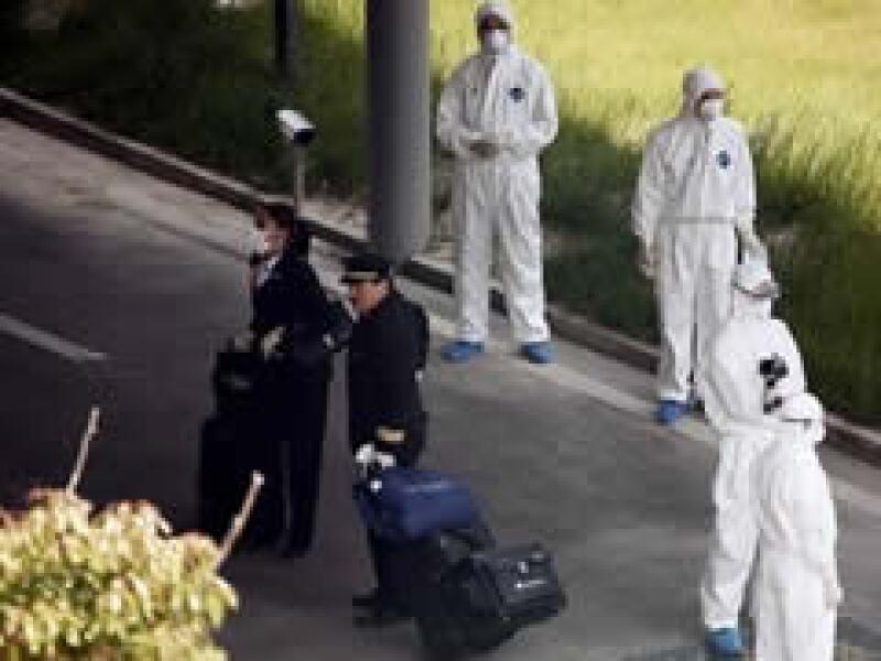 Los epidemiólogos chinos han tomado medidas extremas para evitar contagios de influenza. (Foto: AP)