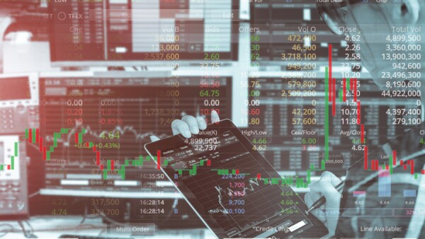 Double exposure of business woman using tablet with stock trading room and stock trading chart background for investment business concept.