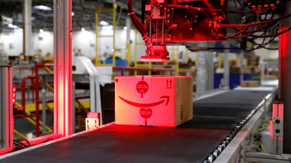 Packaged merchandise on a conveyer belt is labeled for shipping at the Amazon fulfillment center in Robbinsville