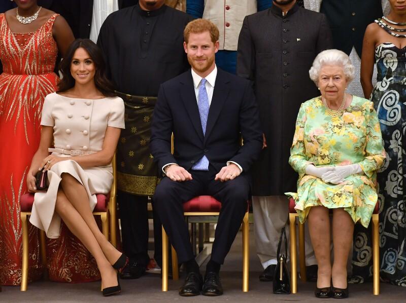 Meghan Markle, príncipe Harry y la reina Isabel
