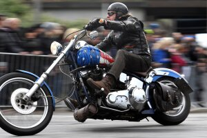 "FILE PHOTO: A biker rides his Harley-Davidson during a parade at the ""Hamburg Harley Days"" in Hamburg"