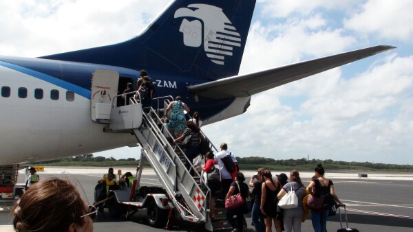 Aeromexico Passengers On Airstair Queuing In Line To Board Airplane At Cancun International Airport Mexico
