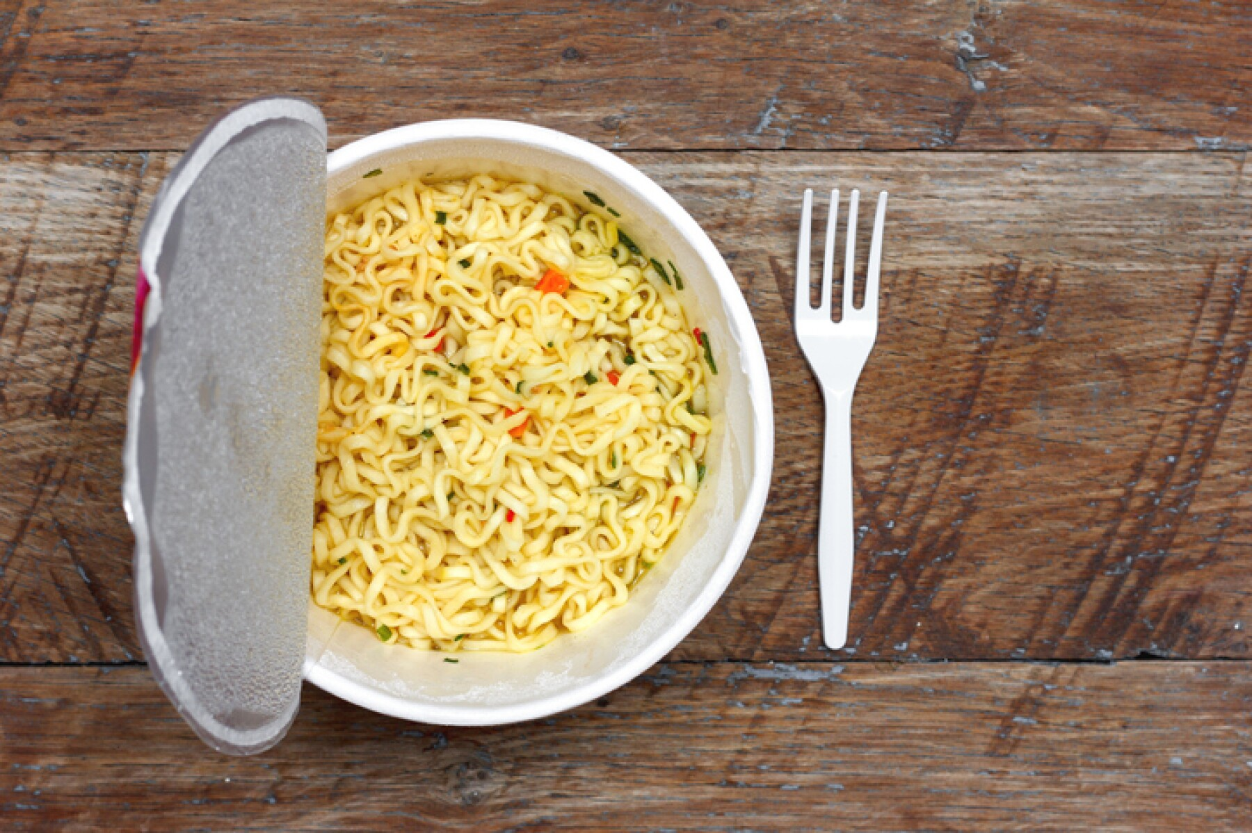 instant noodles on wooden background, top view close-up