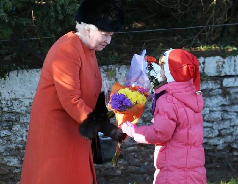 La reina Isabel II también se mostró sonriente.