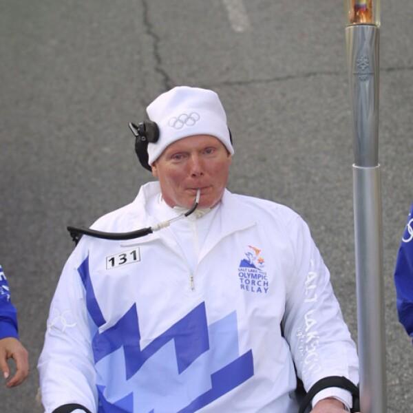 Christopher Reeves corrió con la llama olímpica para Salt Lake 2002.