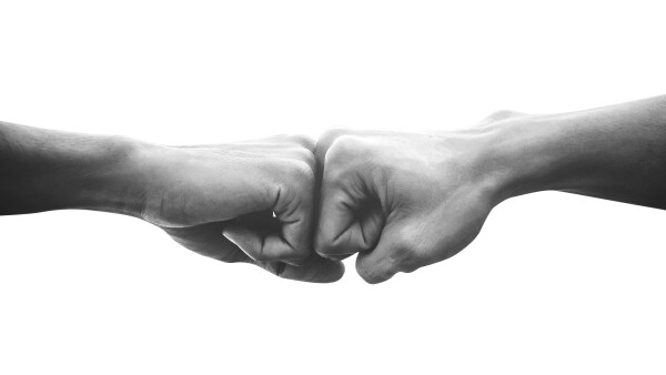 Hands of man people fist bump team teamwork and partnership business success, Black and white image