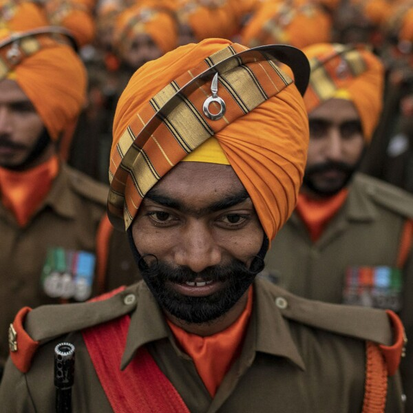 Soldiers take part in the rehearsal for the Republic Day parade in New Delhi