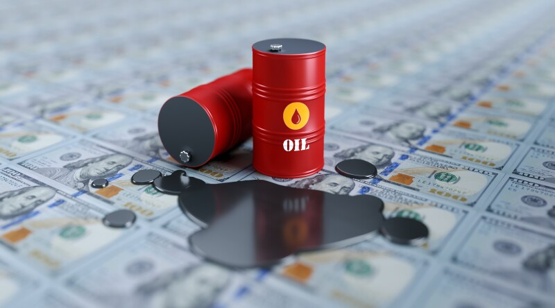 Red Oil Drums Sitting on One Hundred American Dollar Banknotes- Oil Industry Concept