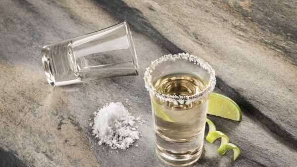 Mexican traditional drink accompanied with lime and salt
