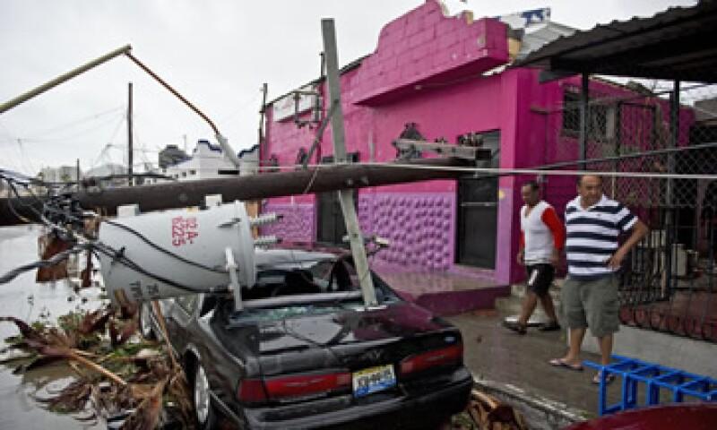 Odile destruyó casas, automóviles, postes de luz, hoteles y otros negocios en Baja California Sur. (Foto: AFP)