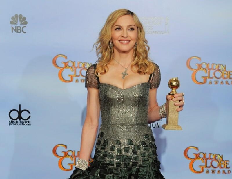 La Reina del Pop se llevó el Globo de Oro por Mejor Canción Original en la película WE.