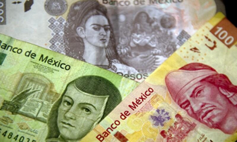 El dólar finalizó en 15.78 pesos en ventanillas. (Foto: AFP )
