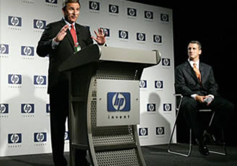 Michael Holston (der) litigó a favor de Mark Hurd (izq) en su proceso para asumir el puesto de CEO de HP en 2006. (Foto: Cortesía Fortune)