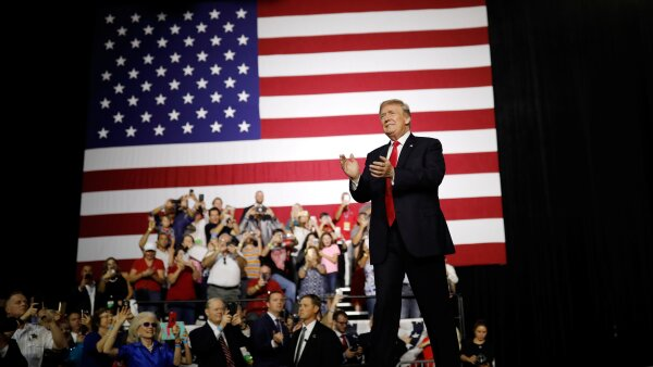 President Donald Trump acknowledges the crowd during the Make America Great Again Rally at the Florida State Fairgrounds in Tampa