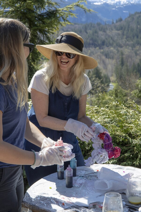 Mother and daughter make tie dye in back yard