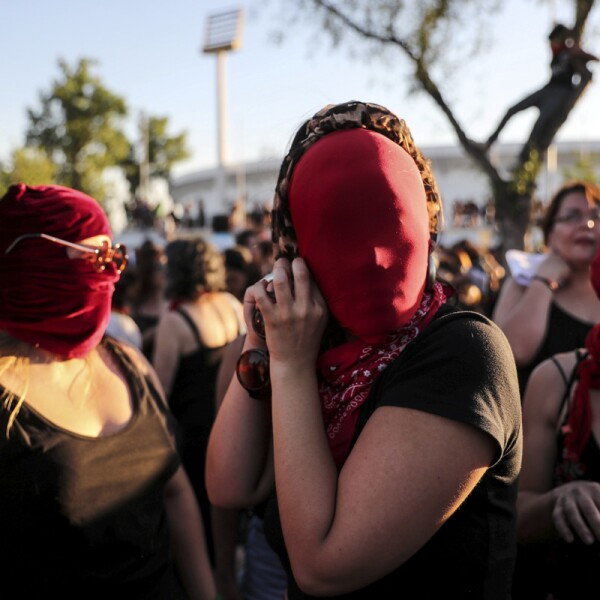 Women rights activists participate in a protest in Santiago