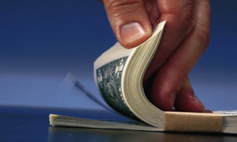 El tipo de cambio podría cotizarse este viernes entre 12.67 y 12.77 pesos por dólar, según Banco Base. (Foto: Getty Images)