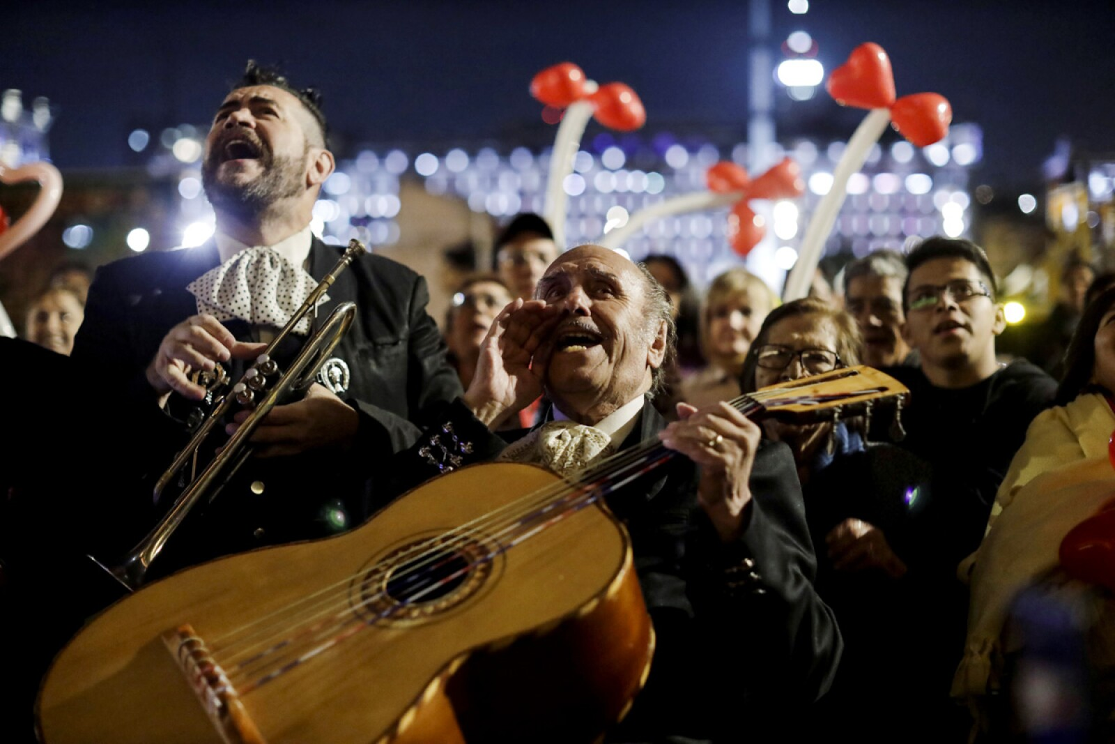 A mariachi sing along supporters of Mexico's President Andres Manuel Lopez Obrador during a serenade for his birthday outside National Palace in downtown Mexico City