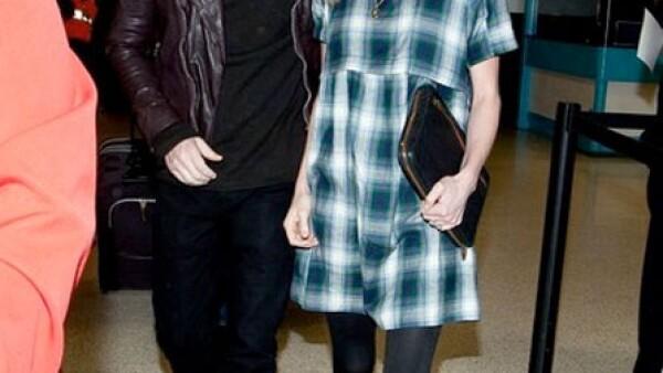 Kate Bosworth suele vestir de Topshop como con este vestido a cuadros con aires grunge.