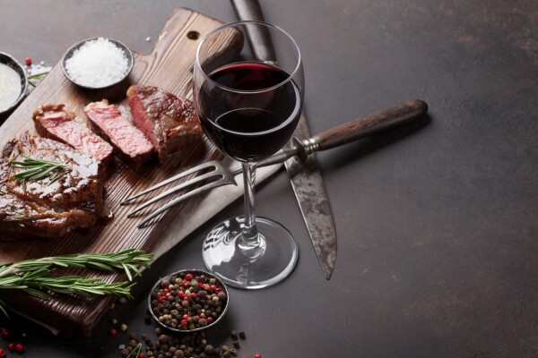 Grilled ribeye beef steak with red wine, herbs and spices
