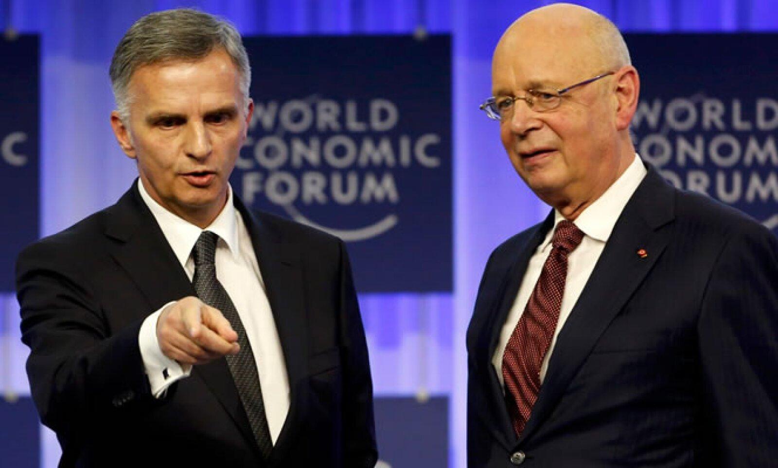 El presidente de Suiza, junto con el fundador Klaus Schwab (d), ofrecieron un discurso de bienvenida a todos los asistentes.