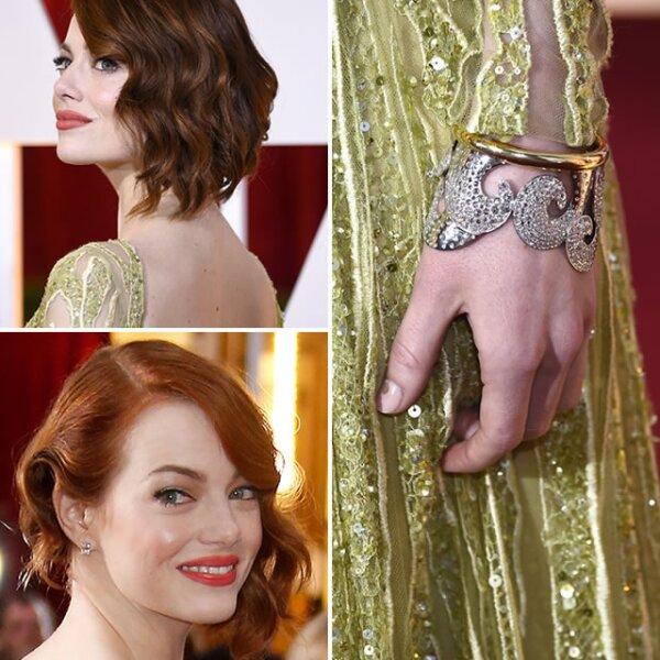 Para combinar con el hermoso vestido Elie Saab, Emma Stone usó un earcuff de diamantes con corte de rosa, junto con aretes de esmeralda, diamantes y platino de Tiffany & Co.