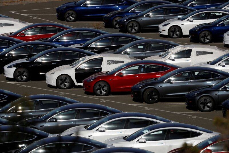 FILE PHOTO: Rows of new Tesla Model 3 electric vehicles in Richmond California