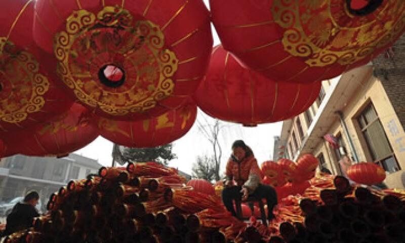 China trata de incentivar su economía con la aprobación de inversiones en la industria. (Foto: AP)