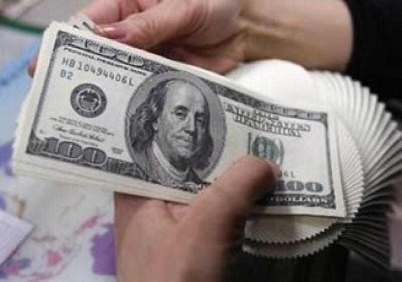 El billete verde cerró la jornada con una ganancia marginal frente al peso mexicano. (Foto: Archivo)